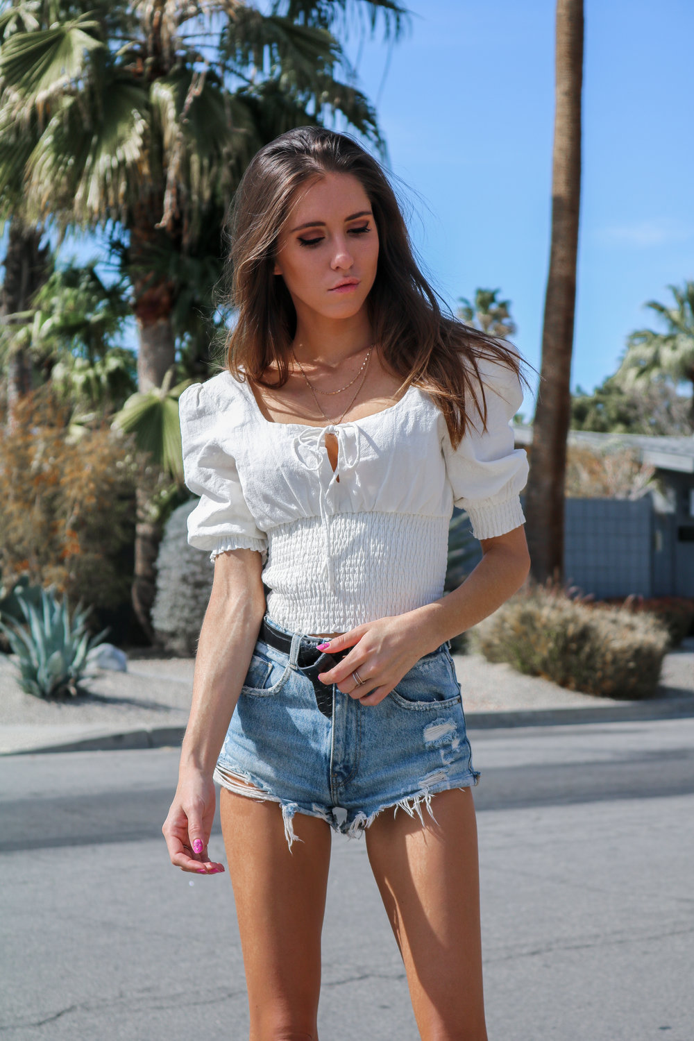 The Hungarian Brunette Puffy sleeves and denim shorts in Palm Springs