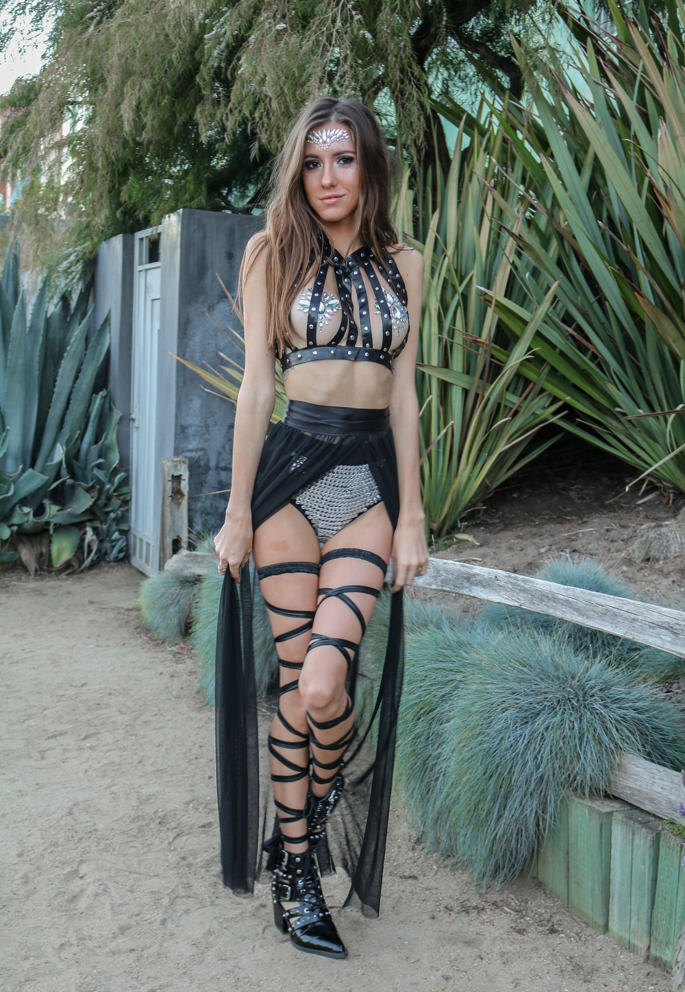 The Hungarian Brunette EDC Meets Coachella festival outfit with Iheartraves, leather harness, bejewelled booty shorts, leg wraps