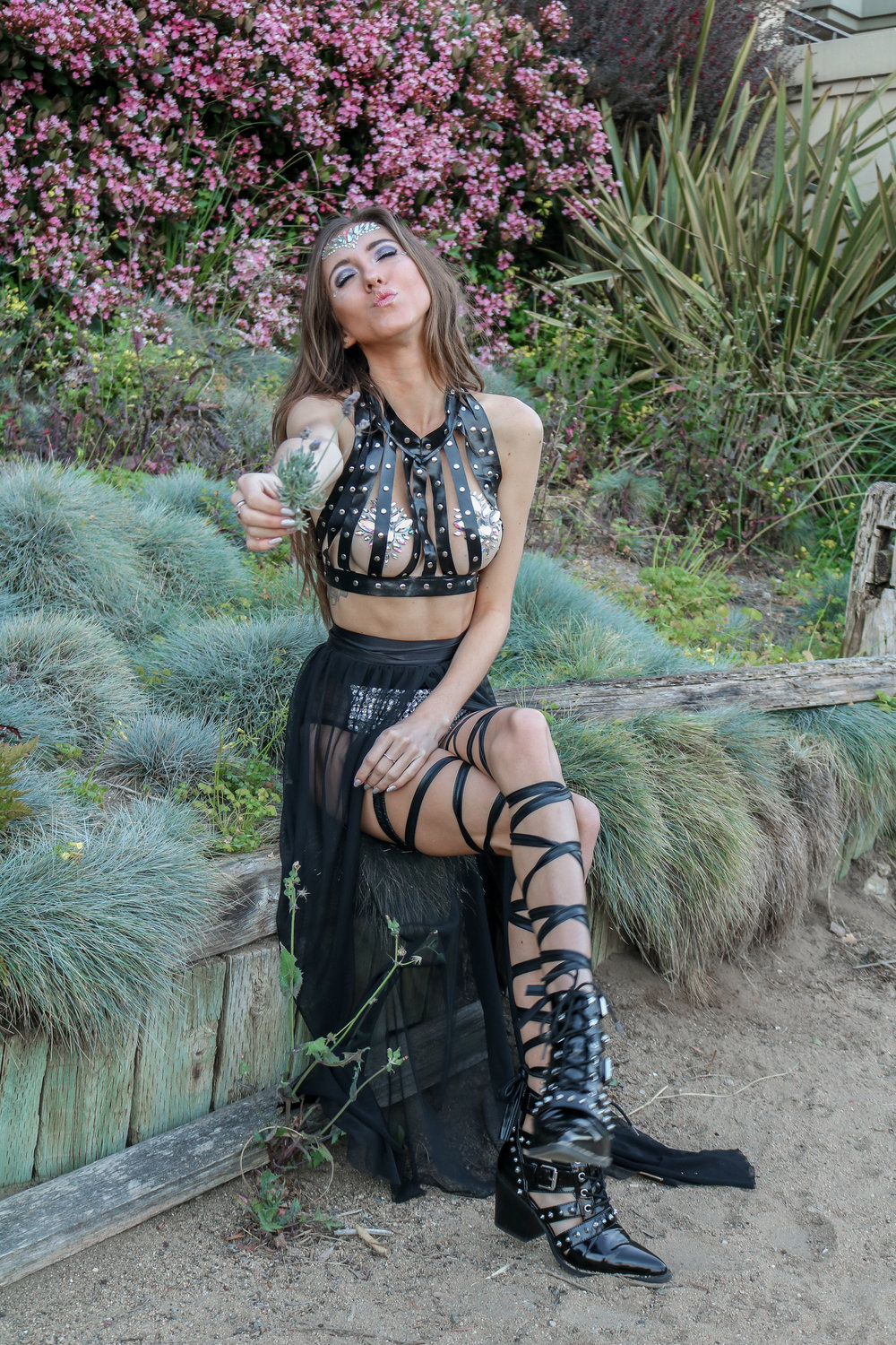 The+Hungarian+Brunette+EDC+Meets+Coachella+festival+outfit+with+Iheartraves%2C+leather+harness%2C+bejewelled+booty+shorts%2C+leg+wraps