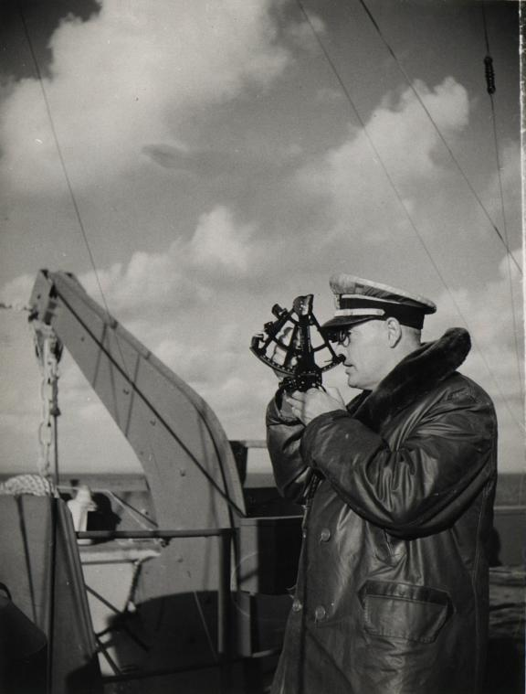 Clifford E. Mosier using a sextant, LST-325 CO, 1943-1945