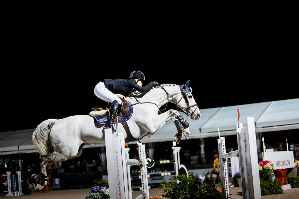 Jenn Gates and Pumped Up Kicks at Winter Equestrian Festival 2019. Photo by Ashley Neuhof Photography.