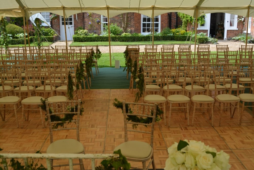 The blessing area was created by using the dance floor space during the day time, then clearing away the chairs while reception drinks were taken in the garden.