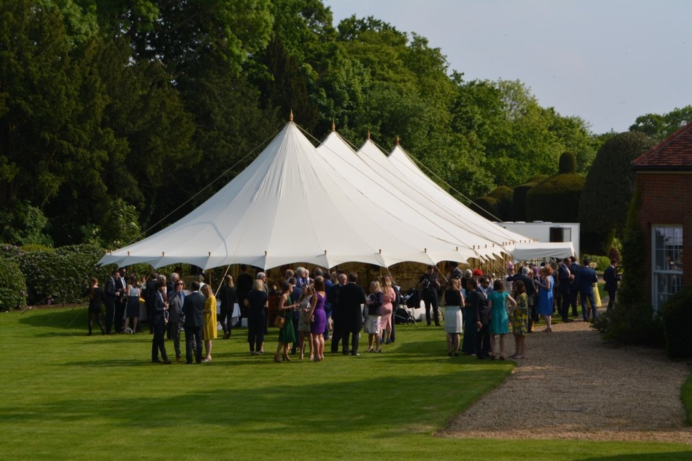 12m x 30m Traditional Marquee within the family grounds with the marquee walls removed.