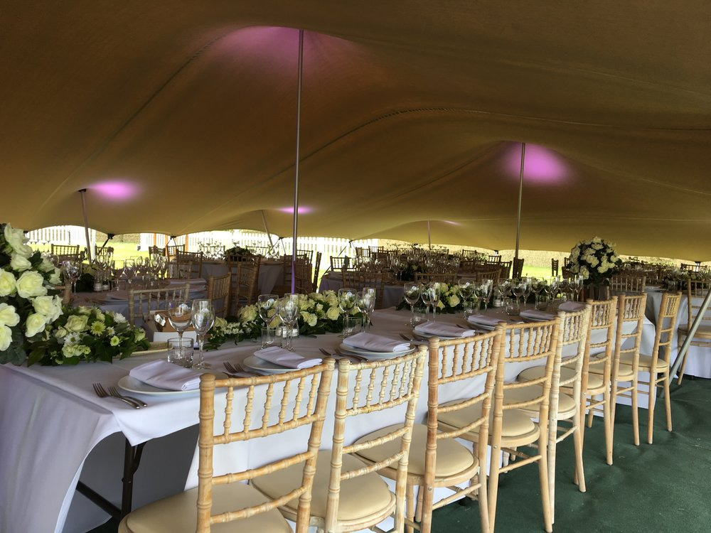 Wedding Breakfast under our Stretch Canopy, We havemany lighting effects to suit your tastes.