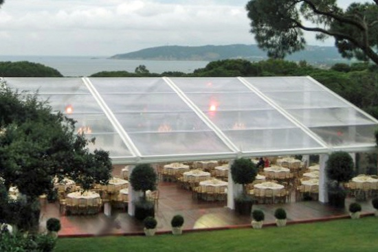 Clearspan Marquee with clear panoramic roofs on solid flooring.