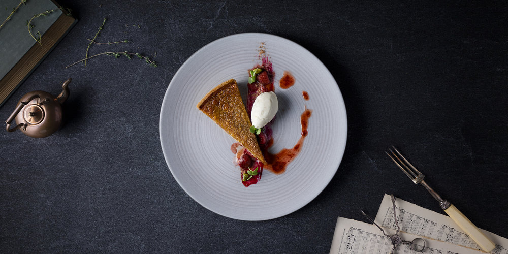 The Grahamston I Treacle Tart served with ginger ice cream, white chocolate, compressed strawberry and crystalized pistachio.