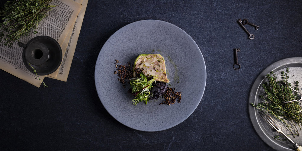 The Grahamston I 'Cock A Leekie' Terrine served with whisky soaked prunes and puffed wild rice.
