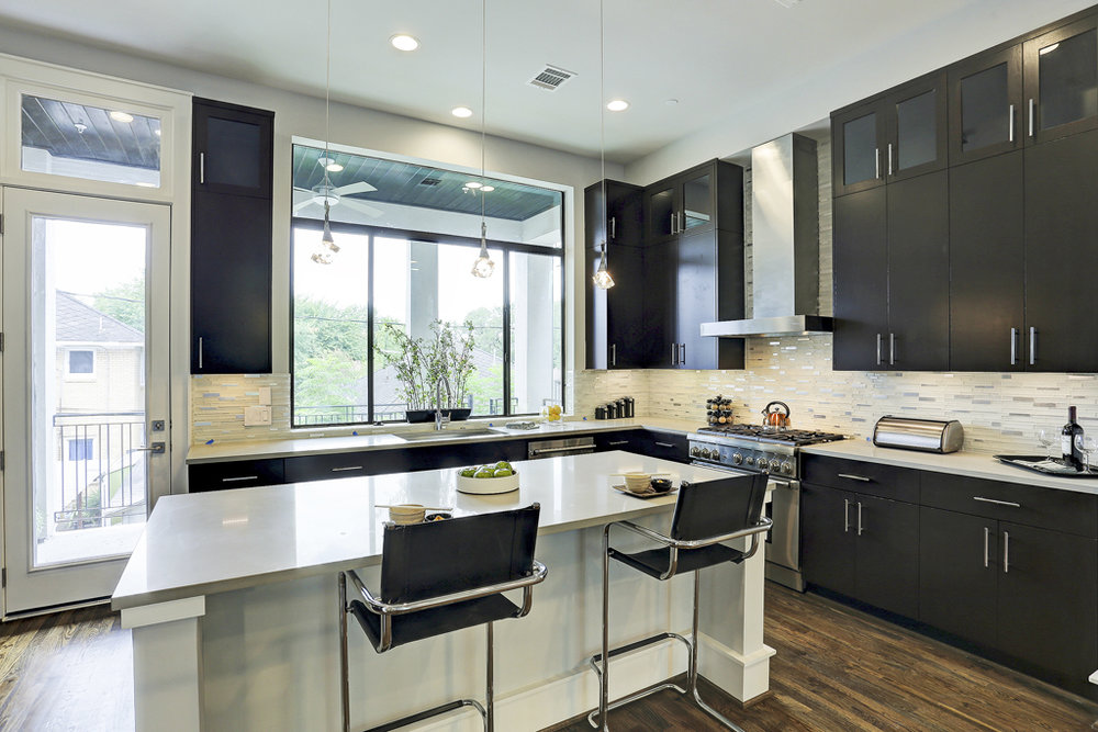 Dream Kitchen w Tall Custom Cabnitry, Large Island & Stainless Thermador Appliances.jpg