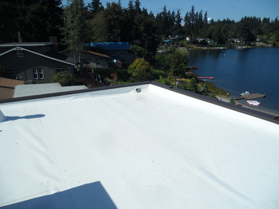 After   Pictured here is our new flat roofing system utilizing a Weatherbond 60 mil TPO roofing system. This system is in all ways superior to the failed roof we replaced and our homeowners were happy!