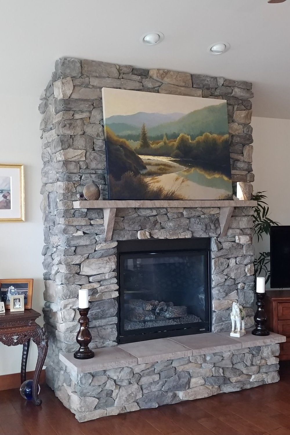 Local Stone Face, Stone Mantle & Raised Hearth with Gas Fireplace