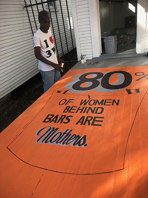 Legendary sign painter, Mr. Walter from the 3rd Ward was commissioned to paint the porch of the (g)Row House