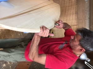 An enthusiastic new woodworker making his hollow wooden board