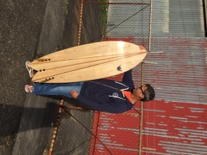 The wonderful finished product.  E and his hollow wooden surfboard.