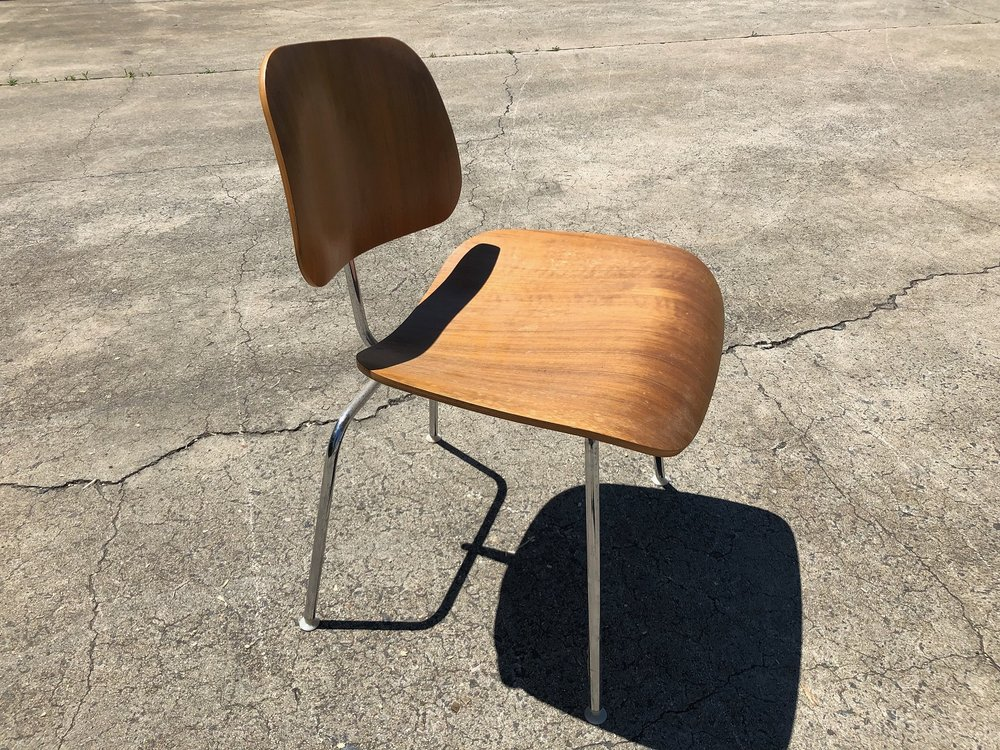 Eames chair prior to restoration and repairs