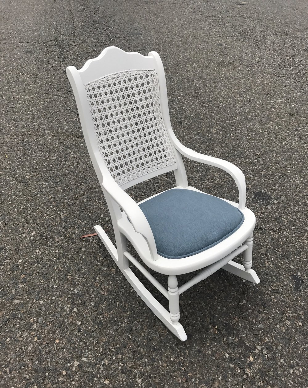restored white rattan rocker