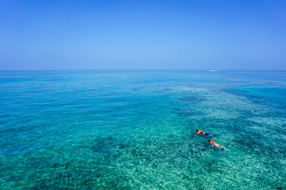 Drone view of a couple doing snorkeling in Marau, just an hour away from Itacaré, Bahia - Brazil