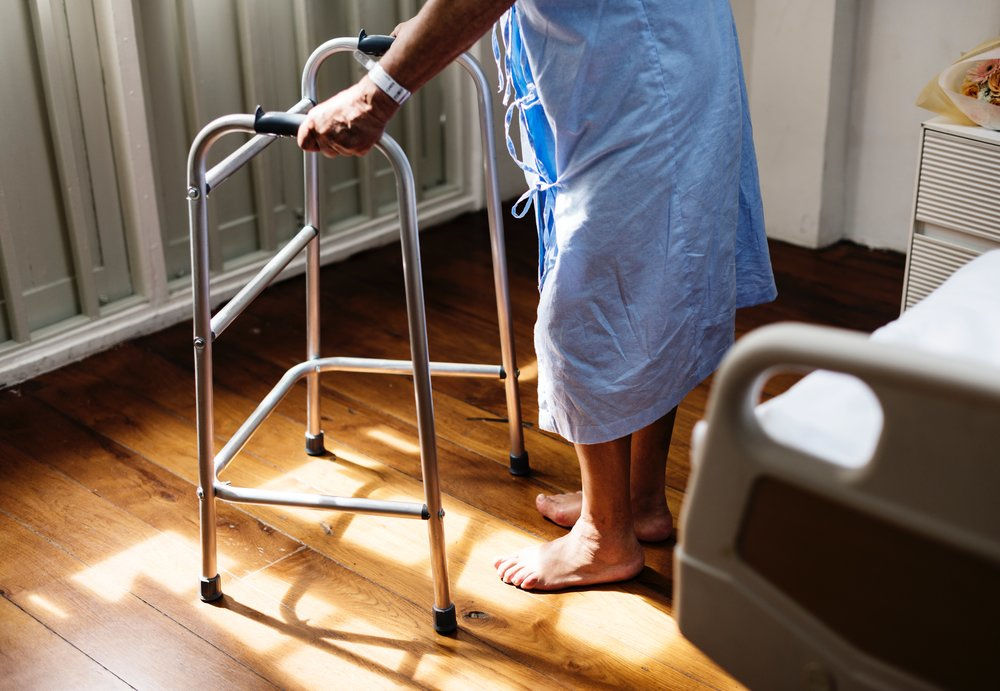Hospital patient using a walker