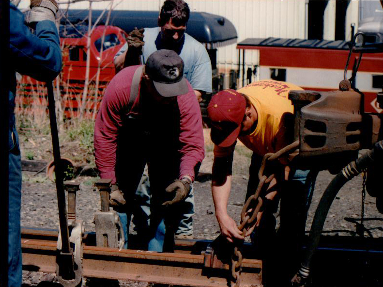 Peterson (in the blue t-shirt) works on a rail installation project in Morristown, New Jersey in 1999.