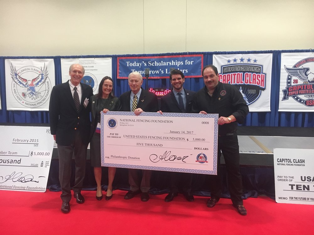 2017 Donation to the United States Fencing Foundation. From left to right (Phil Sbarbaro, Secretary of NFF | Dagmar Johnson, Capitol Clash Organizer | Dennis Molloy, former General Counsel of NFF | Grant Jones, Director of Development of USA Fencing | Alexandre Ryjik, President of NFF)