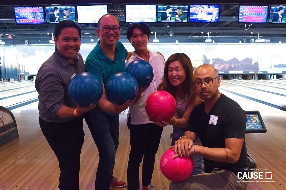 Members of the CAUSE network posing with bowling balls