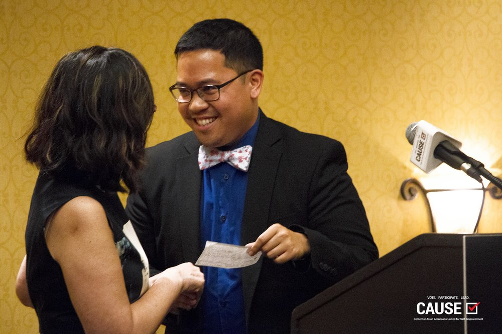 AndyMike presents the funds raised by the 2018 CAUSE Leadership Institute to Asians and Pacific Islanders with Disabilities of California