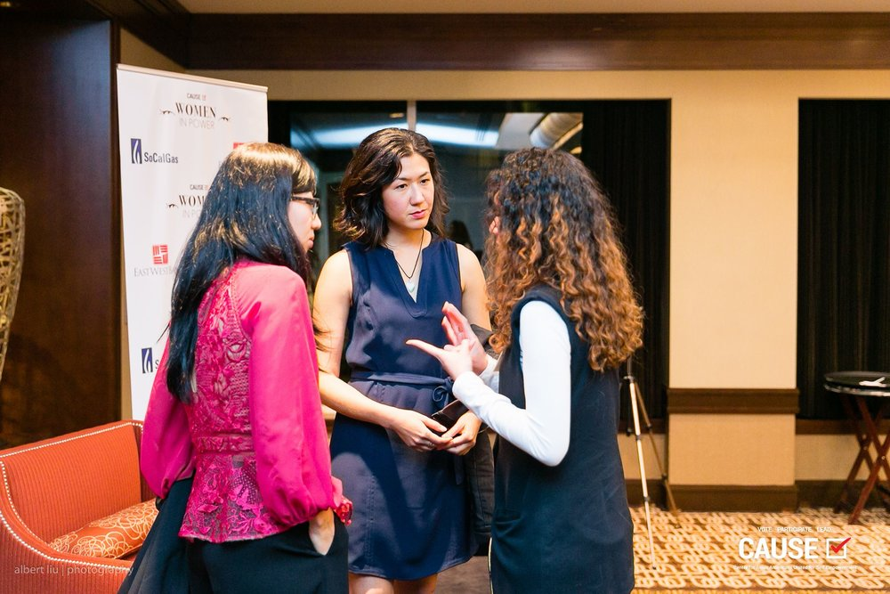 """Suzy Ryoo and Tracy Lawrence answering guest questions at the 2018 CAUSE Women in Power """"Leading Through Workplace Patriarchy"""" Networking Reception"""