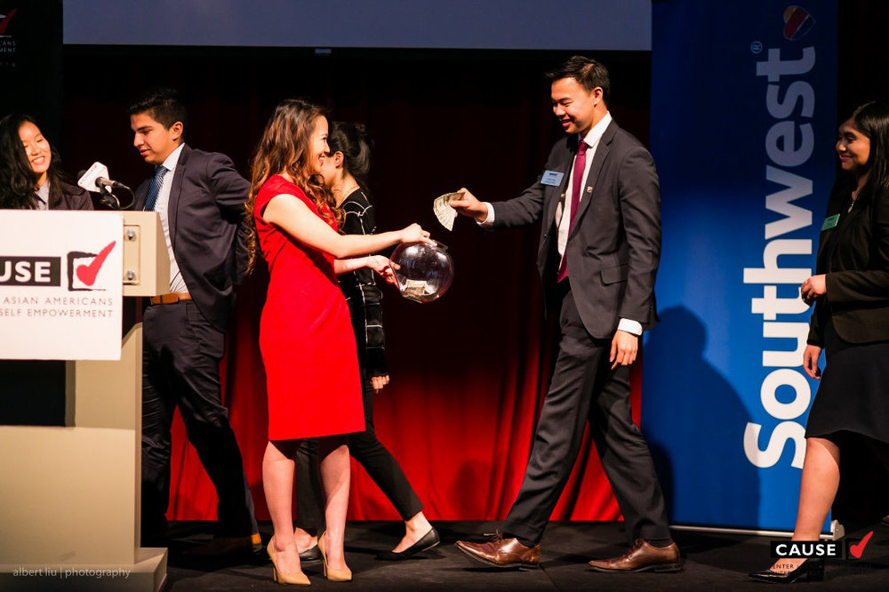 Kim Yamasaki accepting donations for CAUSE at the 2016 CAUSE Leadership Academy Graduation