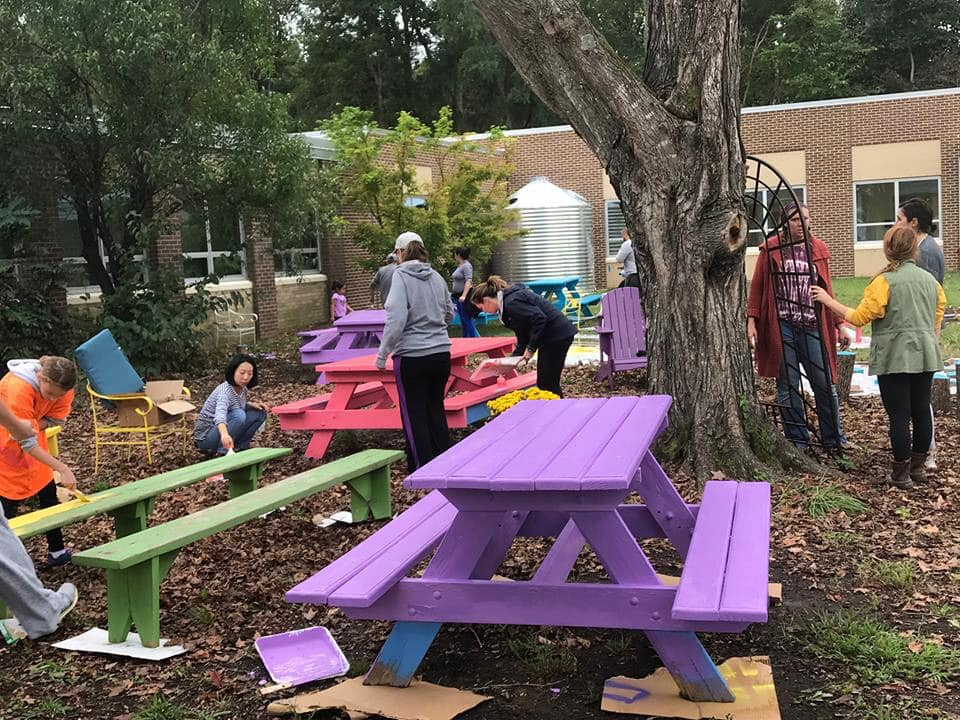 "School and Community Volunteers work on the Outdoor Classroom during a ""Second Sundays"" work day."