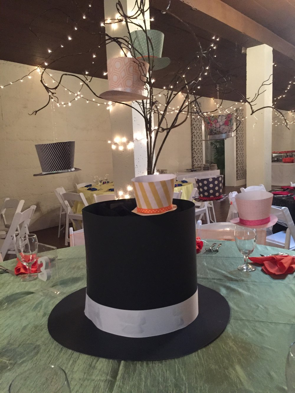 The Mad Hatter table was decorated with a giant top hat and smaller hanging top hats- Wonderland is nothing if not over the top!