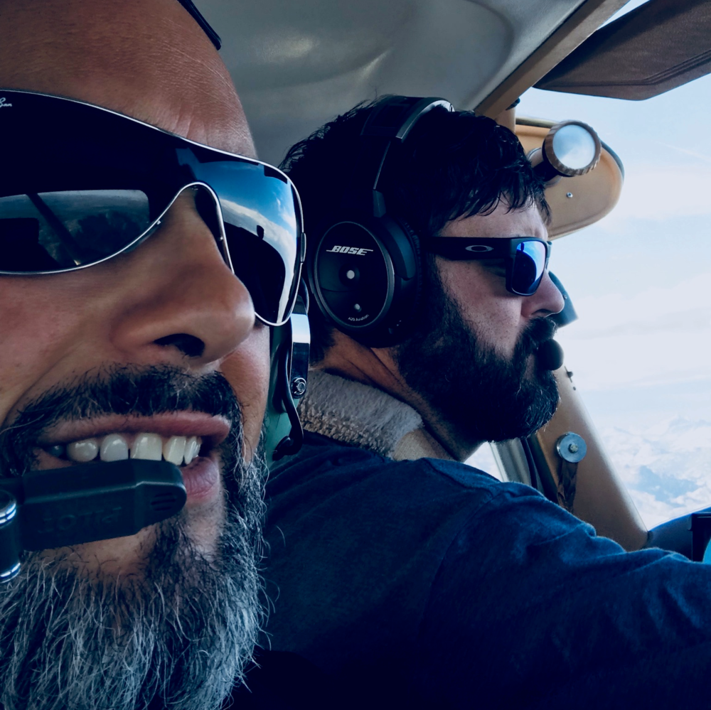 Scott Rexwinkle taking Mike Gordon on his first small plane ride over Yosemite.