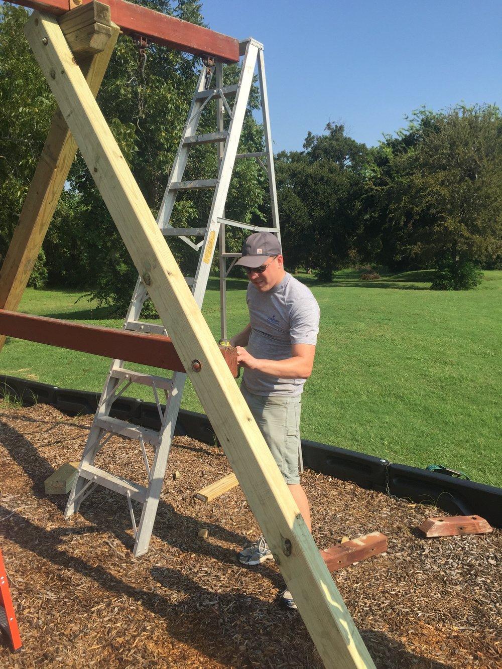 Volunteers repairing St. Martin's playground.