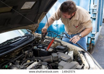stock-photo-auto-mechanic-using-jumper-cables-to-charge-a-car-battery-14943574-335x238.jpg