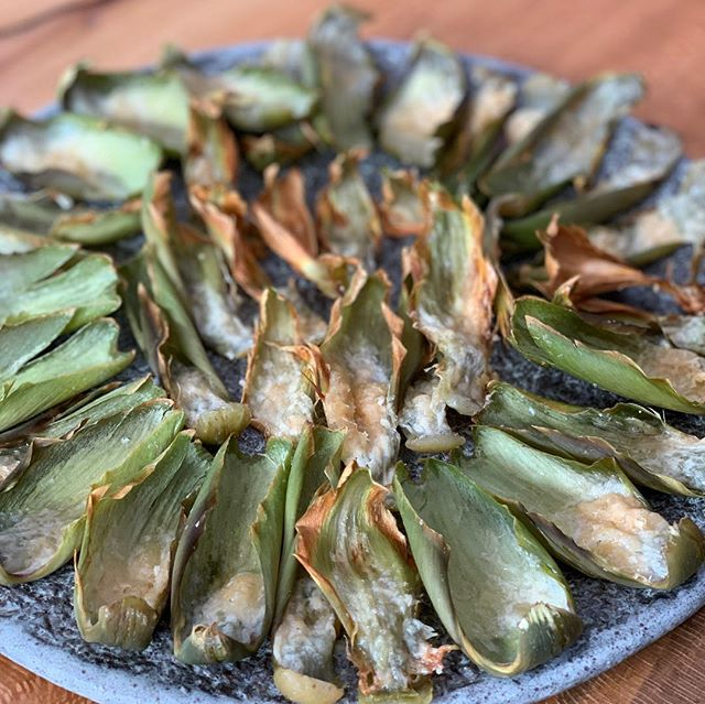 "Another @superbowlsnack Cheesy ""Artichips."" A good way to use the leaves, roasted artichokes with parmigiano. Swipe left for #recipevideo."