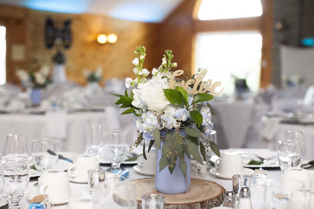 blue white rustic summer woodsy wedding ceremony reception flowers L'Oasis De L'ile montreal rustic centerpiece