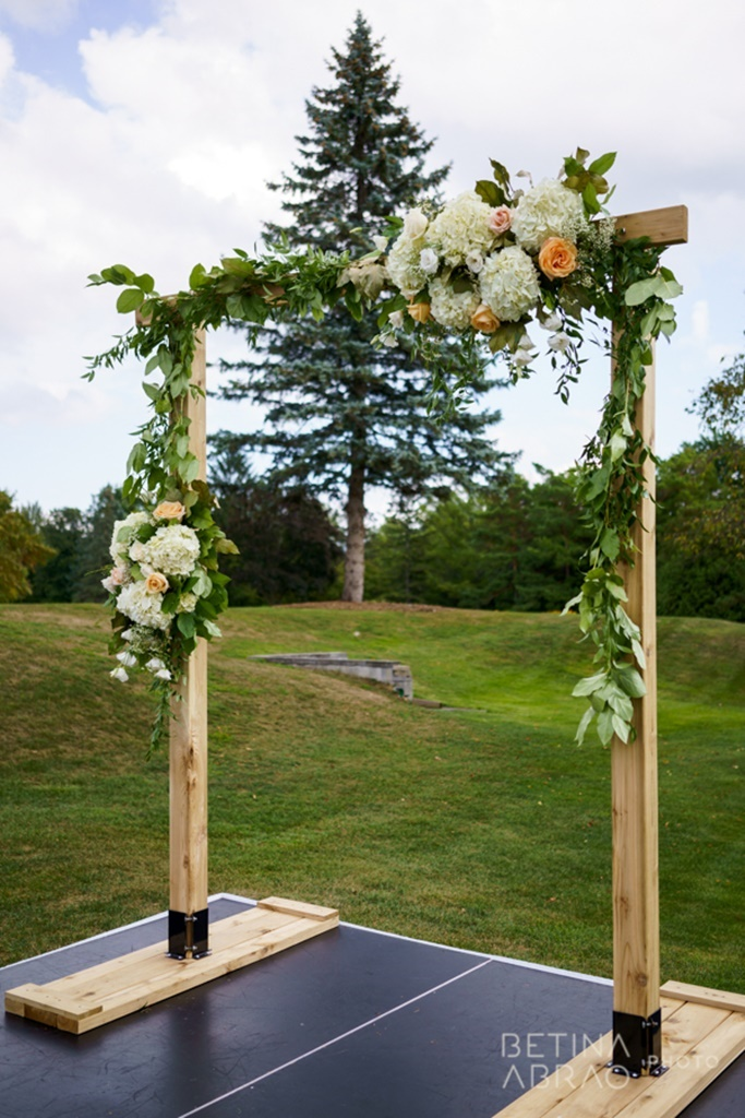 Peach Rustic Wedding at Elm Ridge Golf & Country Club Ile Bizard Montreal Ceremony Wooden Arch and Flowers N+J03.jpg