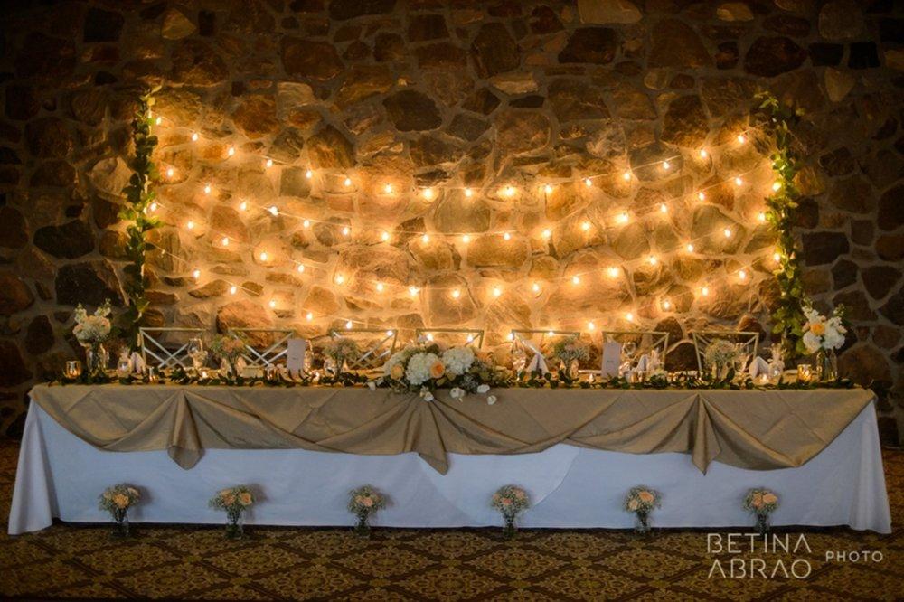 Peach Rustic Wedding at Elm Ridge Golf & Country Club Ile Bizard Montreal Head Table Bistro Lights Backdrop N+J07.jpg
