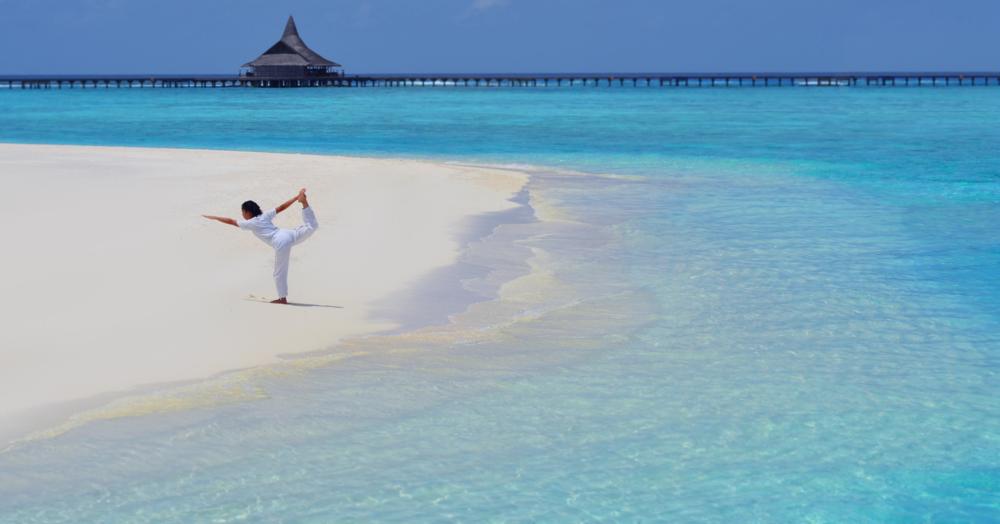 Anantara_Dhigu_Spa_Yoga on the beach.png