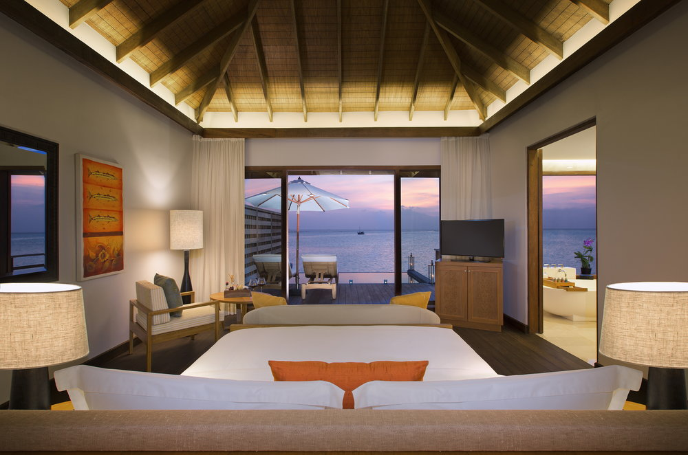 Anantara Veli Resort & Spa_ Deluxe Over Water Pool Bungalow bedroom (1).jpg