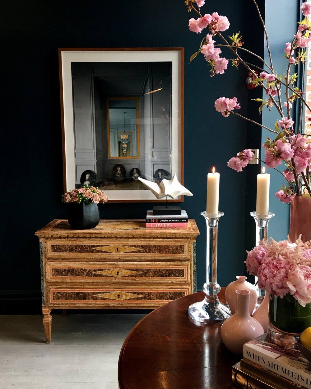 Antiques, art, and accessories share space in the showroom.