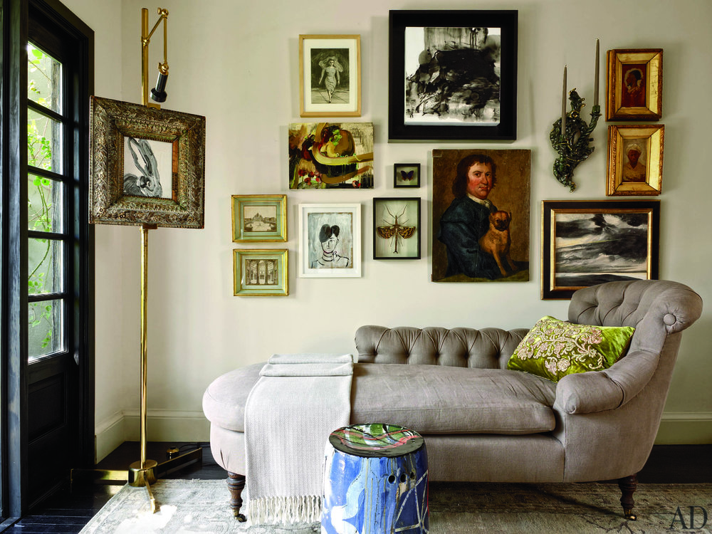 Hunt Slonem's painting Gilt Bunny, set on a vintage Arredoluce lighted easel, takes pride of place in the garden room off the terrace. A custom-made chaise in a  Pierre Frey  fabric is paired with a graffitied ceramic stool by Reinaldo Sanguino.