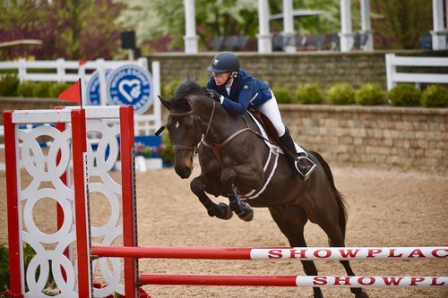 Rebecca and Enzo competing at Lamplight Equestrian Center