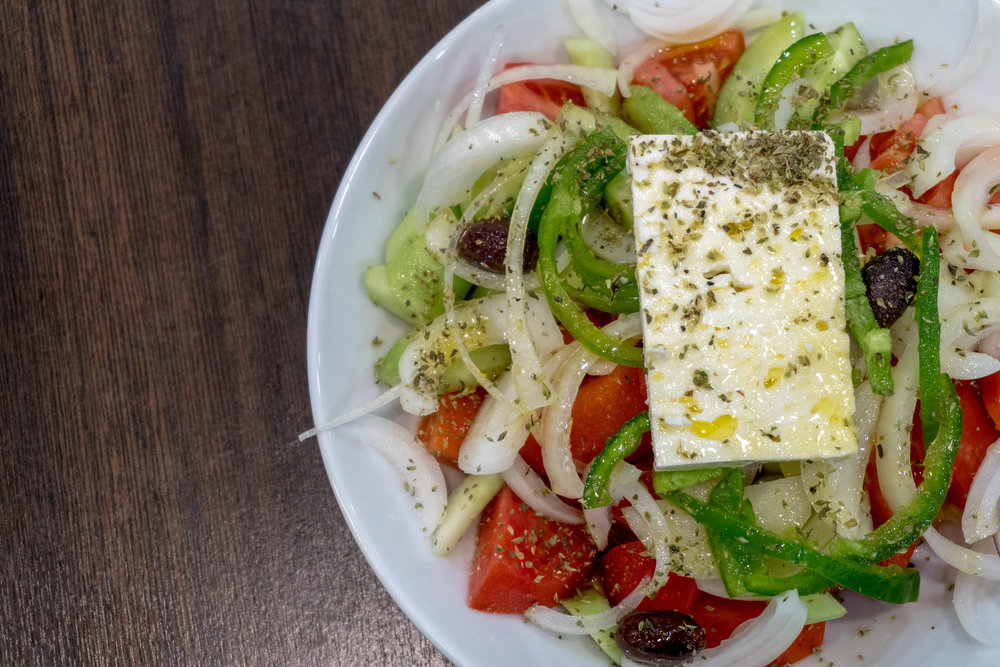 Traditional greek salad , all the vegitables come from local farms , the oregano is collected from the helmos mountain range and the oil is provided from the monastery