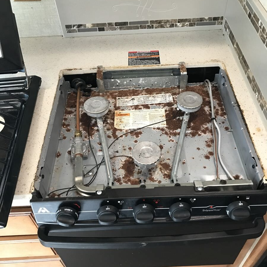 National-RV-Inspection-Services-Water-Leak-RV-Damage-stove-rust.jpeg