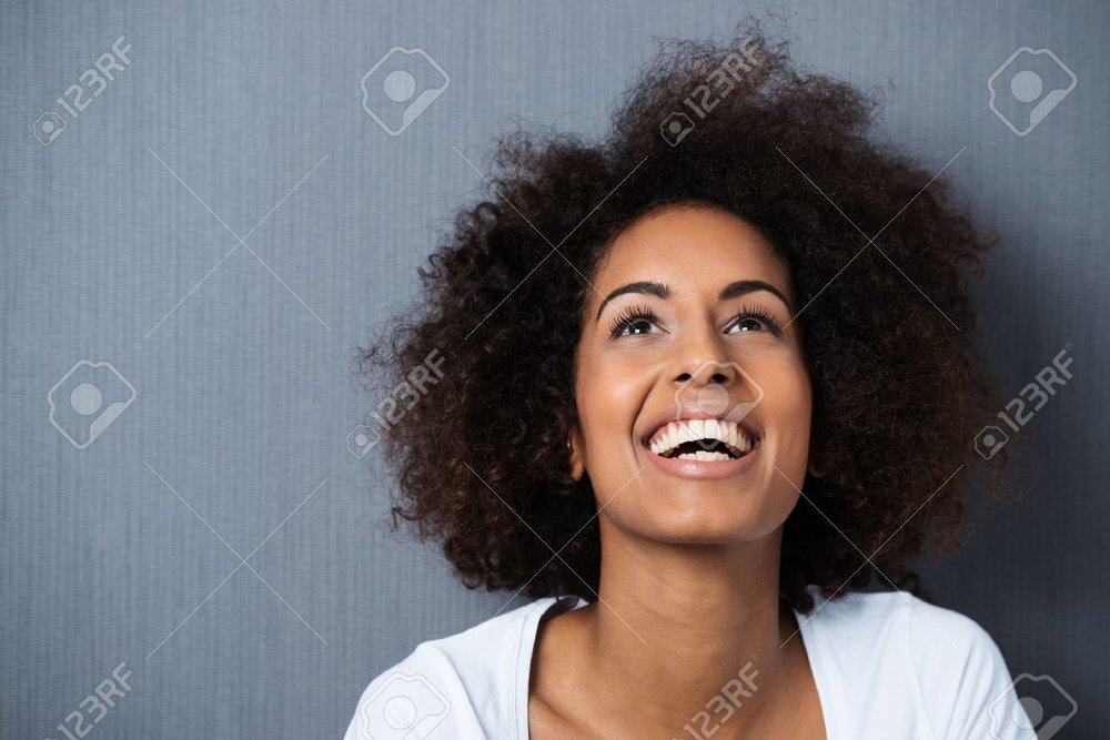 25363169-laughing-african-american-woman-with-an-afro-hairstyle-and-good-sense-of-humour-smiling-as-she-tilts-Stock-Photo.jpg