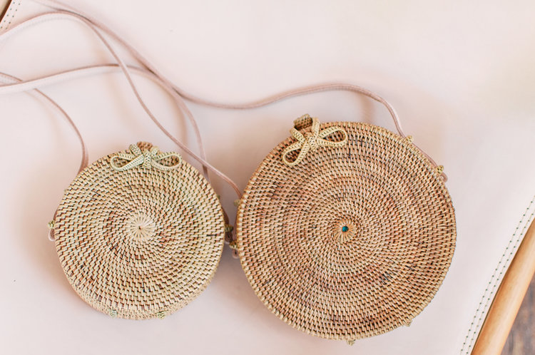 The Balinese Cross Body purse: Mini in Natural (left) and Regular in Maple (right).