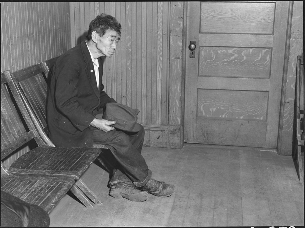 Toshi Mizoguchi, an Issei farmer and a bachelor, is captured here in a solemn expression by Dorothea Lange in 1942
