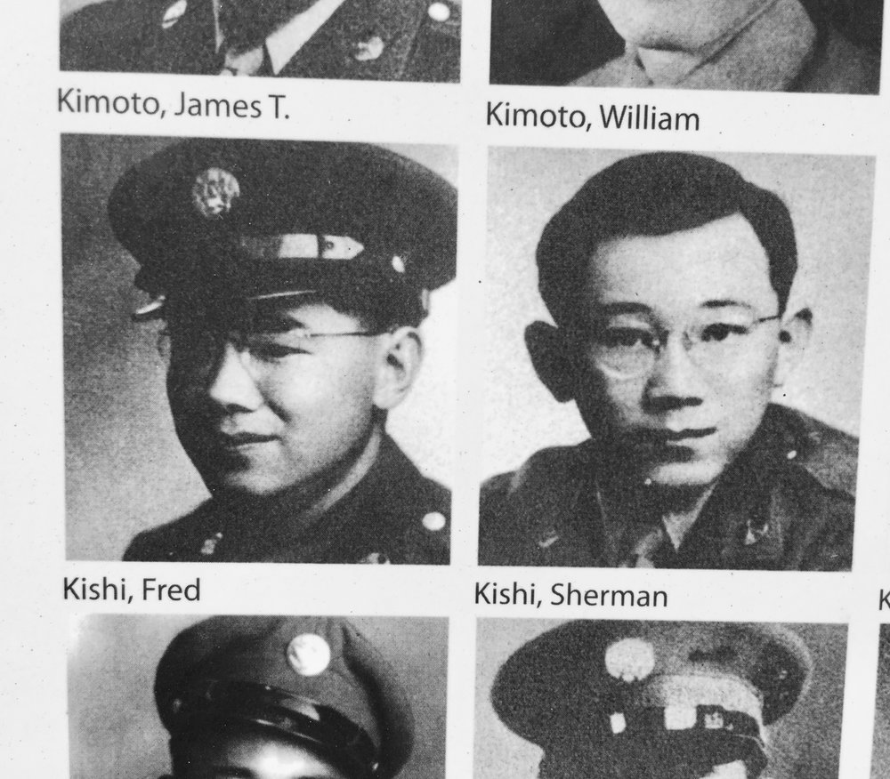 """Military photos of Sherman and his older brother, Fred are displayed on plaques at the Merced Assembly Center Memorial. """"From this small community there were a lot of us that went into the service. I think from Cortez and Livingston, there were sixty young men. And there weren't that many Japanese people,"""" says Sherman."""