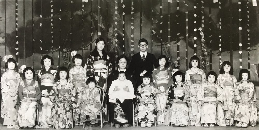 Mary's mother (center), her future step-father, and her students