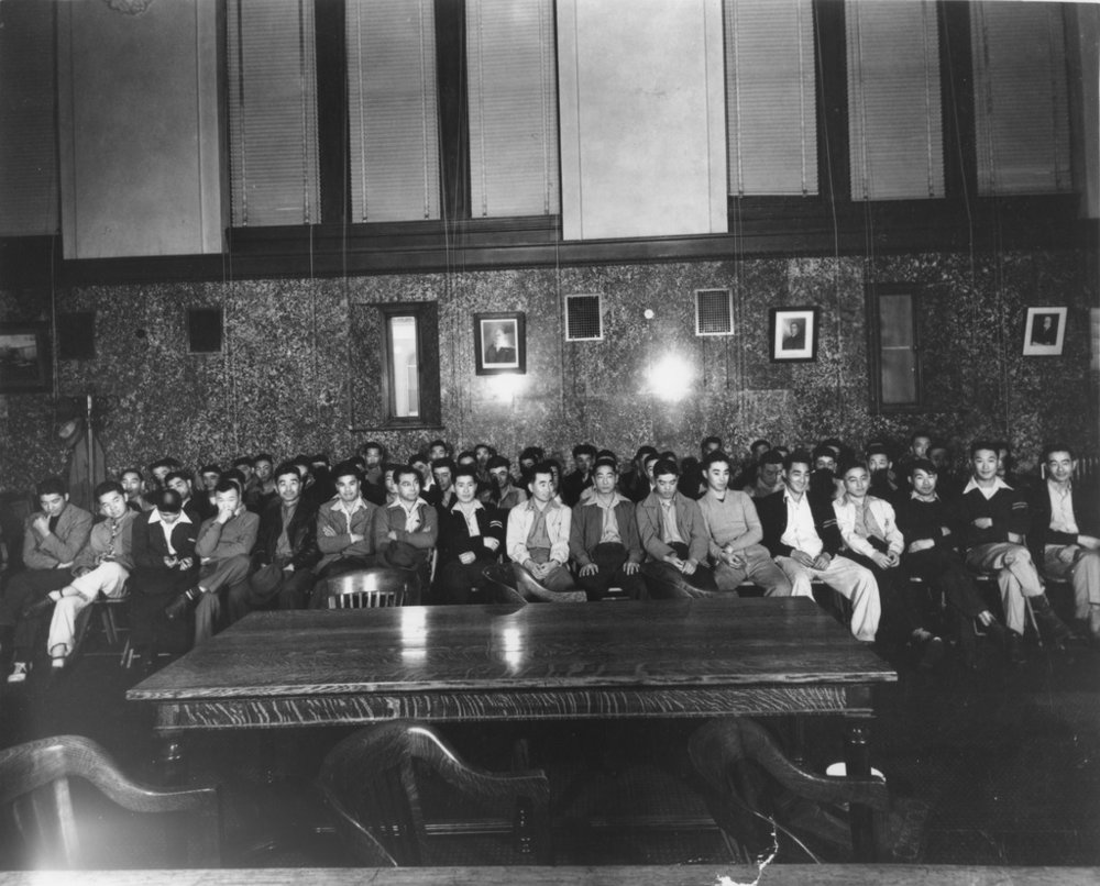 Kazuki's brother, Kazuto, is in the front row, fourth from right. Original caption: The first day of the trial of the 63 Heart Mountain draft resisters in Federal District Court, Cheyenne, Wyoming on June 12, 1944. Photo: Courtesy of Frank Abe
