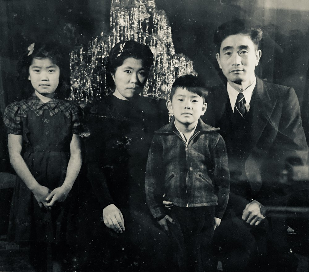 The last Oki family photo taken before the camps. From left to right: Yuri, Yayoi, Kaz, and Kazuichi (Jack)